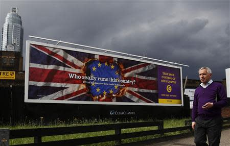 A pedestrian passes a United Kingdom Independence Party European elections campaign poster in Vauxhall, central London