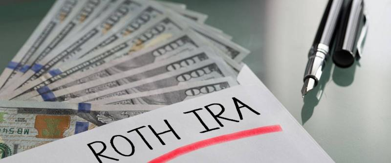 Savings for retirement concept with Roth Ira written on white envelope with cash US dollars