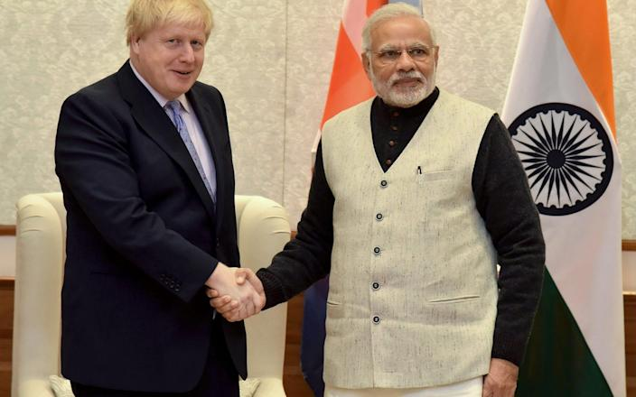 The trip, which had already been scaled down from the original plans, would have been Boris Johnson's first major bilateral visit to another country - AFP