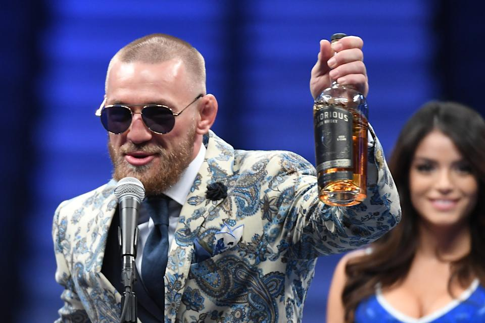 Conor McGregor speaks during a news conference while holding up his Notorious-branded Irish whiskey after his loss to Floyd Mayweather Jr. by 10th-round TKO in their super welterweight boxing match on August 26, 2017 at T-Mobile Arena in Las Vegas, Nevada.