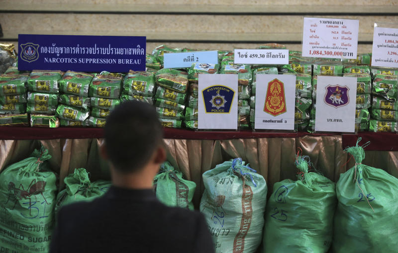 FILE - In this July 15, 2019, file photo, reporters view packages of seize 459 kilograms (1,012 pounds) of crystal methamphetamine on a table during a press conference at Narcotics Suppression Bureau Bangkok, Thailand. United Nation's Office on Drugs and Crime, said the cumulative value of the methamphetamine market is more than $60 billion this year. Facilitated by organized crime, the market has expanded since a 2013 study found the accumulated value was $15 billion.(AP Photo/File)