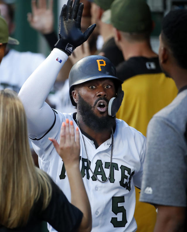 Pittsburgh Pirates' Josh Harrison celebrates as he returns to the dugout after hitting a two-run home run off New York Mets starting pitcher Steven Matz during the third inning of a baseball game in Pittsburgh, Thursday, July 26, 2018. (AP Photo/Gene J. Puskar)