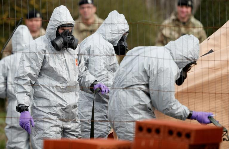 British Military personnel wearing protective coveralls helping investigate the March 4 nerve agent attack on a former Russian spy and his daughter in Salisbury, England