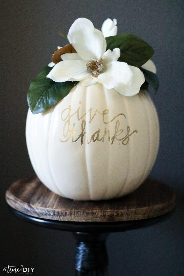 """<p>A white pumpkin accented with a faux magnolia leaf and a calligraphed message is the centerpiece of your most sophisticated Thanksgiving dreams. </p><p><strong>Get the tutorial at <a href=""""https://lollyjane.com/diy-magnolia-pumpkin/"""" rel=""""nofollow noopener"""" target=""""_blank"""" data-ylk=""""slk:Lolly Jane"""" class=""""link rapid-noclick-resp"""">Lolly Jane</a>.</strong></p><p><strong><a class=""""link rapid-noclick-resp"""" href=""""https://www.amazon.com/Rinlong-Artificial-Magnolia-Branches-Decoration/dp/B07MMMSM1Z?tag=syn-yahoo-20&ascsubtag=%5Bartid%7C10050.g.1371%5Bsrc%7Cyahoo-us"""" rel=""""nofollow noopener"""" target=""""_blank"""" data-ylk=""""slk:SHOP FAUX MAGNOLIA BLOOMS"""">SHOP FAUX MAGNOLIA BLOOMS</a></strong></p>"""