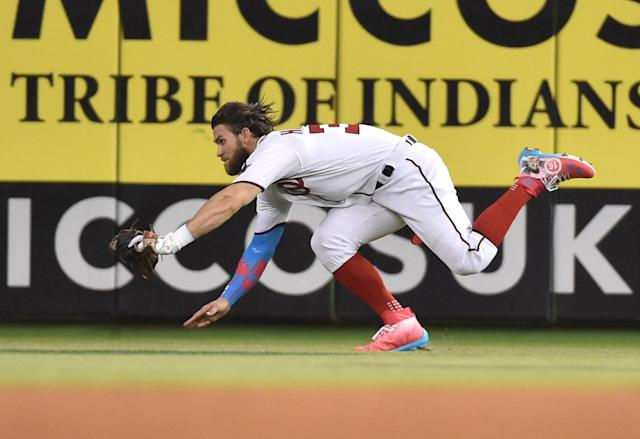 <p>National League outfielder Bryce Harper (34) makes a diving catch on a ball hit by American League catcher Salvador Perez in the second inning during the 2017 MLB All-Star Game at Marlins Park. (Steve Mitchell-USA TODAY Sports) </p>