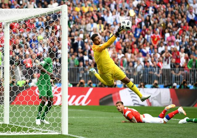 <p>Abdullah Almuaiouf of Saudi Arabia makes a save from a Fedor Smolov effort in the first half. (PA) </p>