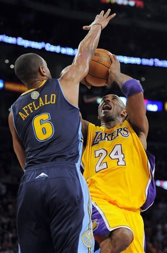Los Angeles Lakers guard Kobe Bryant (24) shoots as Denver Nuggets guard Arron Afflalo defends during the first half of Game 7 in their first-round NBA basketball playoff series, Saturday, May 12, 2012, in Los Angeles. (AP Photo/Mark J. Terrill)