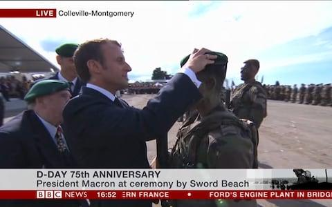 Macron presents a young commando with his green beret - Credit: BBC