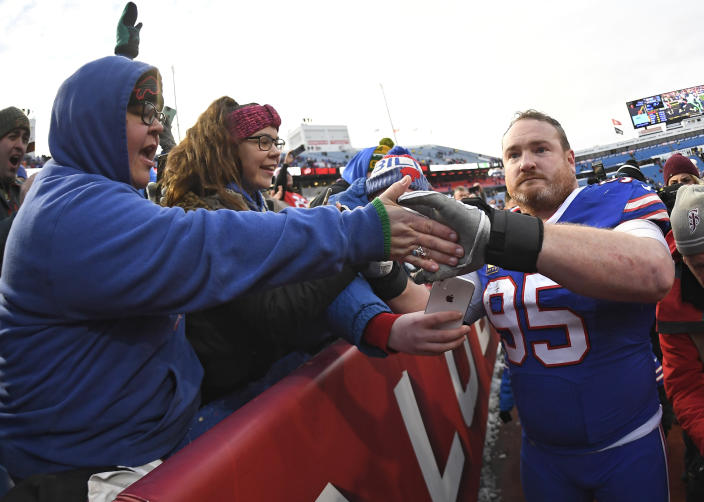 Buffalo Bills defensive tackle Kyle Williams greets fans after an NFL football game against the Miami Dolphins, Sunday, Dec. 30, 2018, in Orchard Park, N.Y. The Bills won 42-17. (AP Photo/Adrian Kraus)