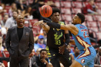 South Florida forward B.J. Mack (33) passes past Florida State guard M.J. Walker (23) as Florida State head coach Leonard Hamilton, left, yells out in the first half of an NCAA college basketball game, part of the Orange Bowl Classic tournament, Saturday, Dec. 21, 2019, in Sunrise, Fla. (AP Photo/Wilfredo Lee)