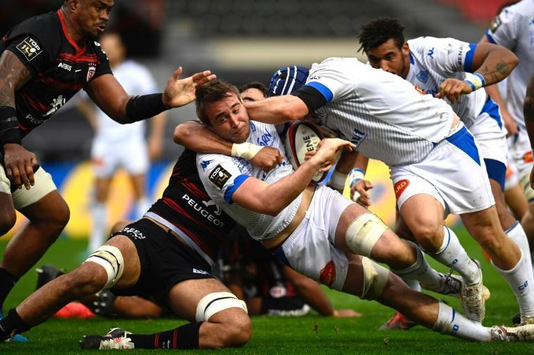 Grab and go: Castres flanker Anthony Jelonch is tackled by Toulouse's Australian lock Richard Arnold