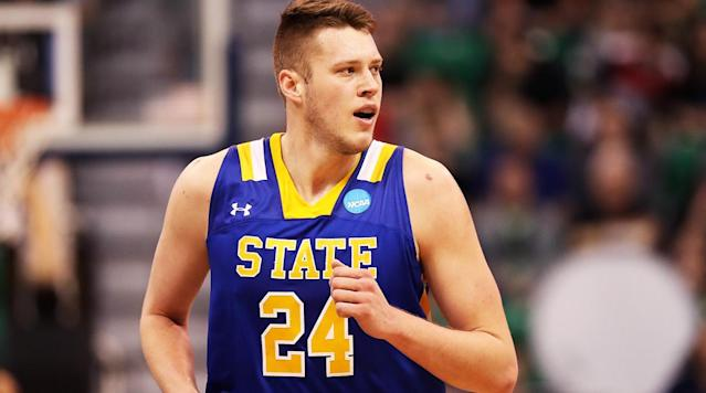 """<p>BOISE, Idaho – """"So,"""" Mike Daum is asked, """"About that nickname…""""</p><p>He's sitting inside a cramped locker room at the Taco Bell Arena, as his face reddens and teammates around him snicker and laugh and nudge each other's elbows. The Dauminator shrugs and beings his explanation. He has dealt with this mockery before.</p><p>The small-college forward with the NBA skillset and the jump shot that recalls a certain Larry legend chose his Twitter handle back in middle school. Daum had no idea then that he'd shoot his way into a scholarship at South Dakota State, or ascend to levels of, <em>ahem</em>, dominance even his mother never envisioned. Or that said Twitter handle—<a href=""""https://twitter.com/dauminator24?lang=en"""" rel=""""nofollow noopener"""" target=""""_blank"""" data-ylk=""""slk:@dauminator24"""" class=""""link rapid-noclick-resp"""">@dauminator24</a>—would become not only his nickname but an accurate description of his play.</p><p>Back then, Daum—known then, now and, hopefully, forever as The Dauminator—was a farm kid growing up in small-town Kimball, Neb., population roughly 2,500, if you include the cattle. That's where he developed into the best player casual college basketball fans may or may not have heard of, a two-time Summit League Player of the Year now worthy of his moniker.</p><p>On Thursday, The Dauminator will match up with Ohio State forward Keita Bates-Diop, a future NBA lottery pick and reigning Big Ten Player of the Year. And that's when—should Daum's remarkable ascendance continue in the West Region of the NCAA tournament—the rest of a bracket-obsessed nation will know what those in Jackrabbit Country have known for years now: The Dauminator dauminates.</p><p>Daum averaged 23.8 points and 10.4 rebounds for the Jackrabbits this season, while scoring 30 points or more in 12 games and adding to his growing career total of more than 2,200 career points scored. In fact, Daum is the most efficient high-usage player in this tournament field, scoring 1.1 points per play w"""