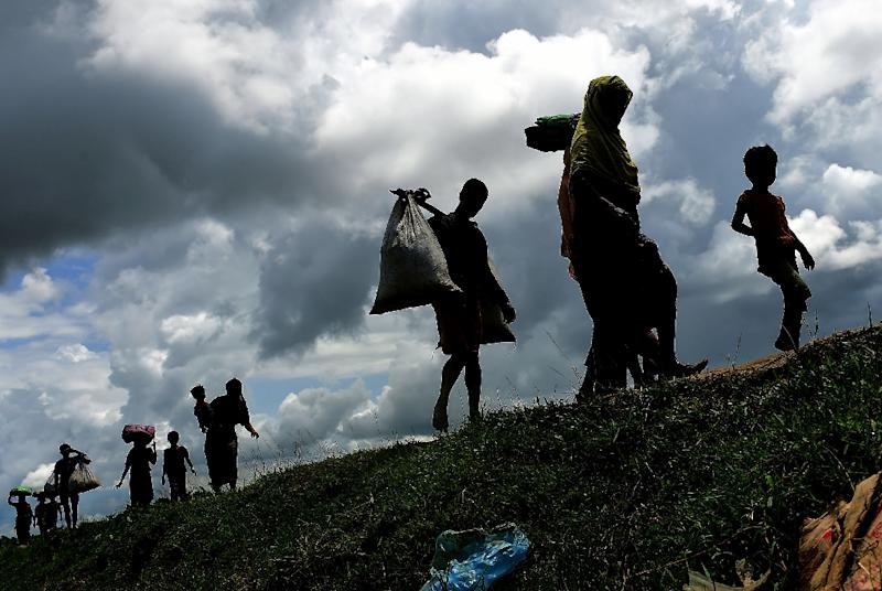 Weary and wounded Rohingya arriving in Bangladesh have told consistent but unverifiable accounts of village massacres, with soldiers and vigilante mobs teaming up to empty out communities and burn them to the ground. (AFP Photo/Munir UZ ZAMAN)