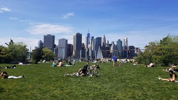 PHOTO: People enjoy a spring day at the Brooklyn Bridge Park Pier 6 during the coronavirus pandemic on May 17, 2020 in Brooklyn, New York. (Justin Heiman/Getty Images)