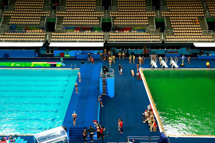<p>AUG. 9, 2016 — General view of the diving pool at Maria Lenk Aquatics Centre on Day 4 of the Rio 2016 Olympic Games at Maria Lenk Aquatics Centre in Rio de Janeiro, Brazil. The water in the diving pool at the Maria Lenk Aquatic Centre had been blue on the 8th, but changed to green overnight, due to what officials called algae, overnight. The water in an adjacent pool remained blue. (Adam Pretty/Getty Images) </p>