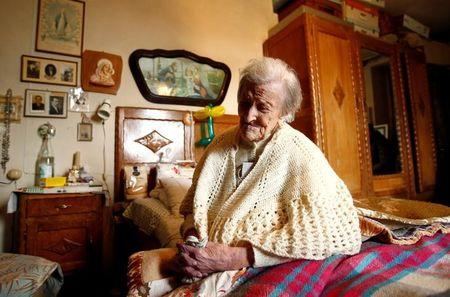 Emma Morano, thought to be the world's oldest person and the last to be born in the 1800s, sits on her bed during her 117th birthday in Verbania