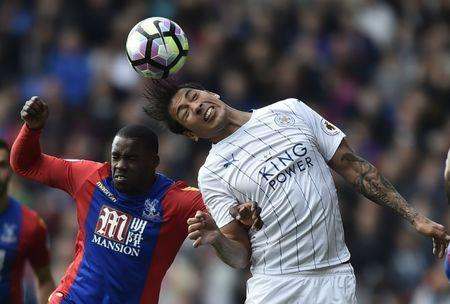 Britain Soccer Football - Crystal Palace v Leicester City - Premier League - Selhurst Park - 15/4/17 Leicester City's Leonardo Ulloa in action with Crystal Palace's Jeffrey Schlupp Reuters / Hannah McKay Livepic