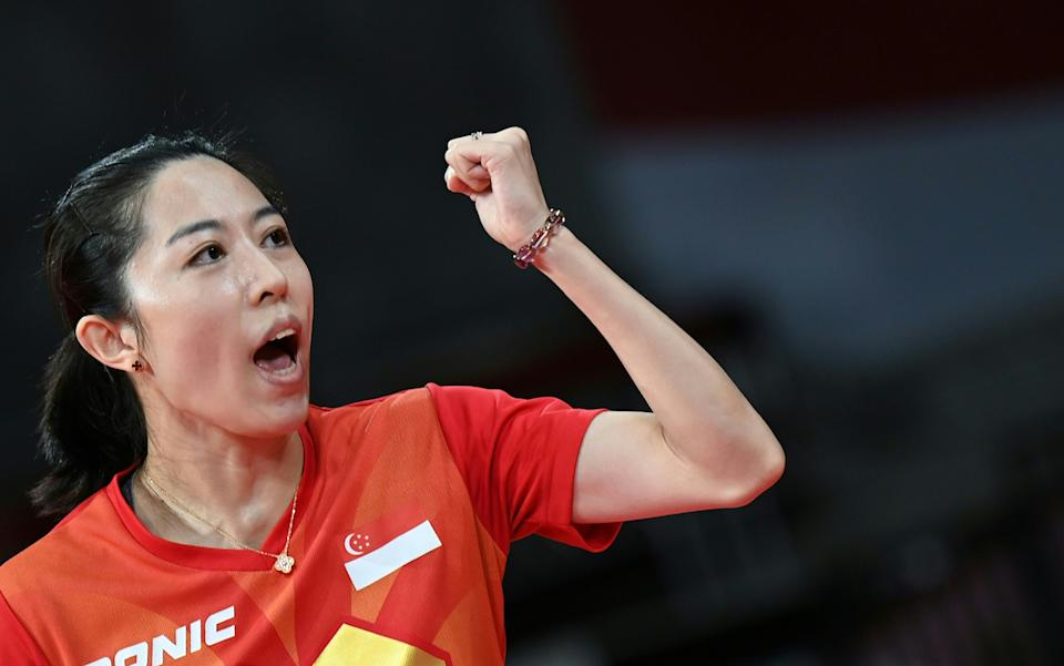 Singapore paddler Yu Meng Yu celebrates a point as she competes against France's Yuan Jia Nan in the women's team competition at the 2020 Tokyo Olympics. (PHOTO: Jung Yeon-je / AFP)