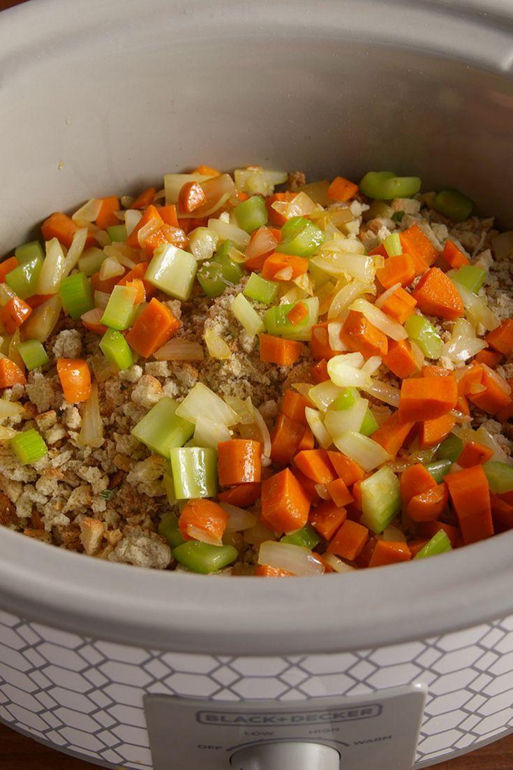 """<p>Save space in your oven by prepping your stuffing in the slow cooker!</p><p>Get the recipe from <a href=""""https://www.delish.com/cooking/recipe-ideas/recipes/a50298/slow-cooker-stuffing-recipe/"""" rel=""""nofollow noopener"""" target=""""_blank"""" data-ylk=""""slk:Delish"""" class=""""link rapid-noclick-resp"""">Delish</a>. </p>"""