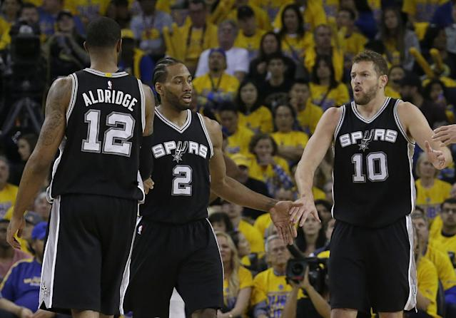 "<a class=""link rapid-noclick-resp"" href=""/nba/players/4896/"" data-ylk=""slk:Kawhi Leonard"">Kawhi Leonard</a> (center) left Game 1 of the West finals after re-injuring his left ankle. (AP)"