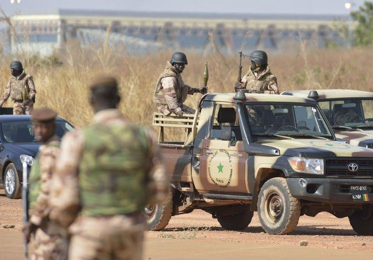 Soldiers are deployed around the 101 airbase near Bamako during a visit by the Malian president on January 16, 2013