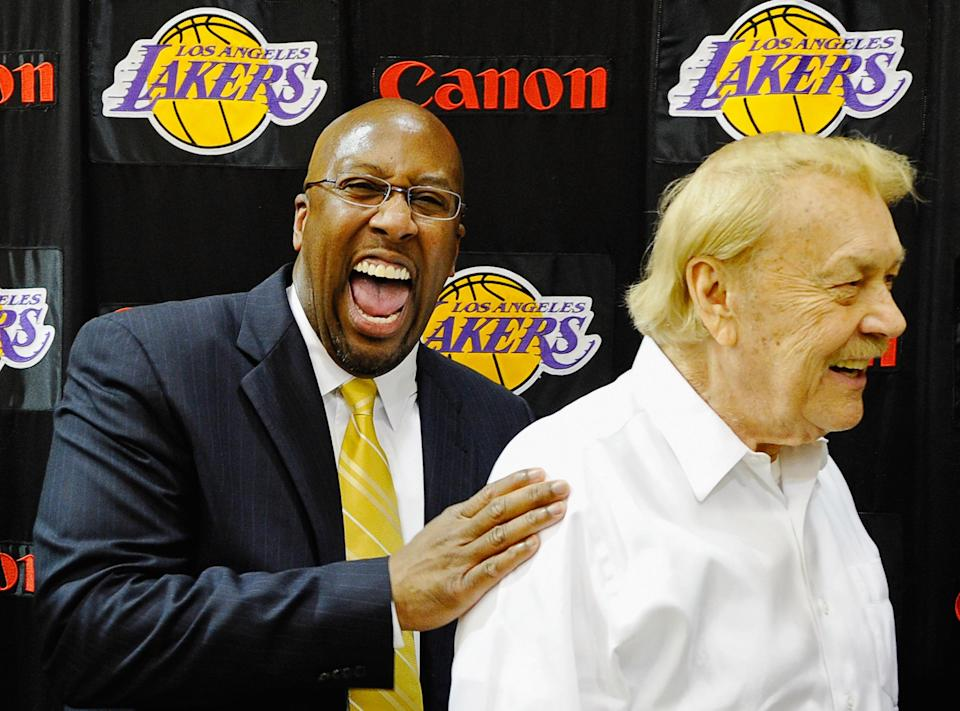 Mike Brown, (L) the new head coach for the Los Angeles Lakers, laughs with team owner Jerry Buss after Brown's introductory news conference at the team's training facility on May 31, 2011 in El Segundo, California. Brown replaces Lakers coach Phil Jackson, who retired at the end of this season. (Photo by Kevork Djansezian/Getty Images)