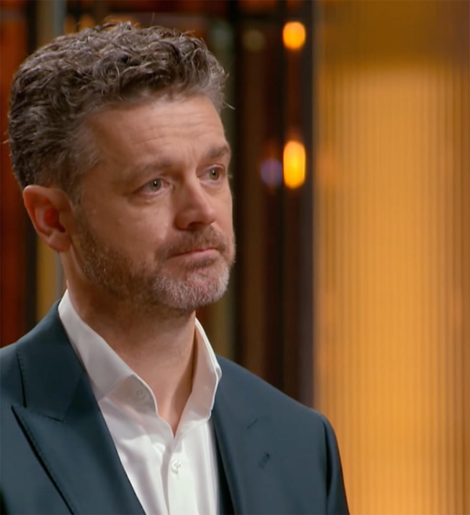 MasterChef Jock Zonfrillo looks concerned and teary on set