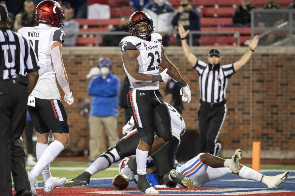 Cincinnati running back Gerrid Doaks (23) celebrates a touchdown run against SMU during the second half of an NCAA college football game Saturday, Oct. 24, 2020, in Dallas. (AP Photo/Jeffrey McWhorter)