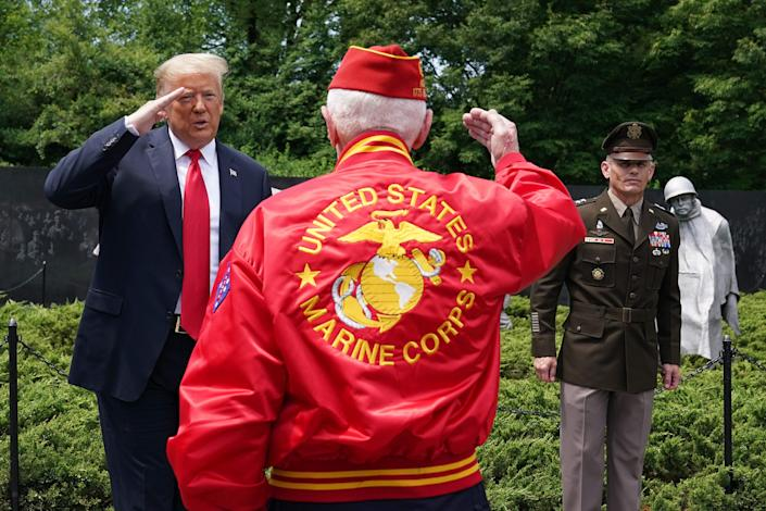 President Donald Trump salutes a veteran during a visit to the Korean War Veterans Memorial in Washington, DC on June 25, 2020. -