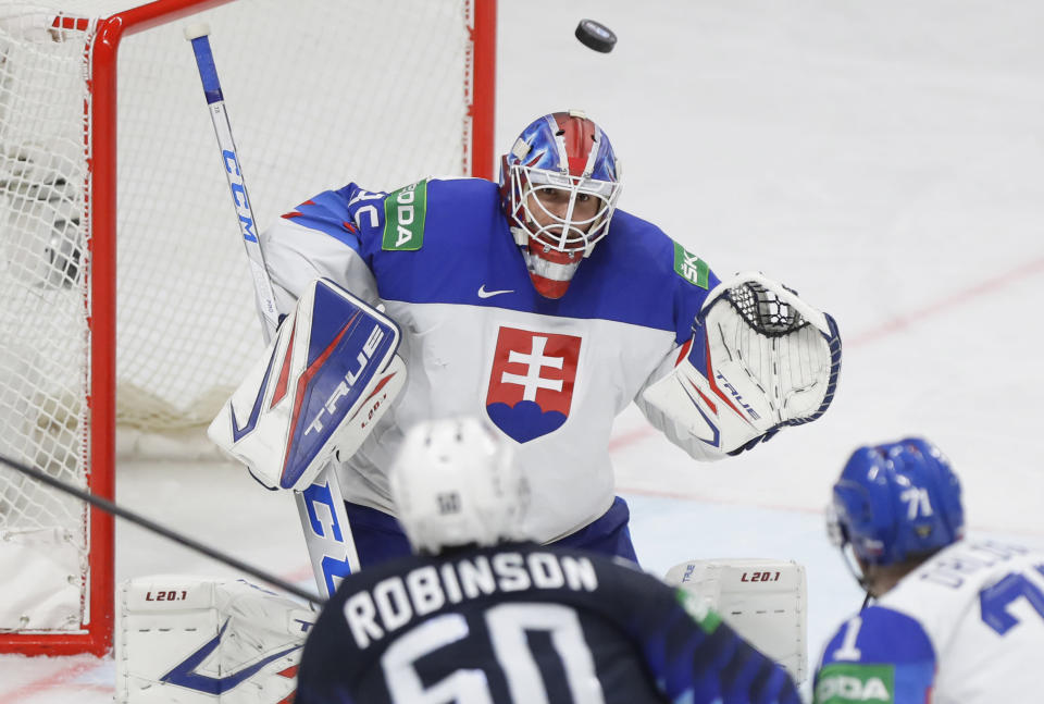 Slovakia's goaltender Adam Huska in action during the Ice Hockey World Championship quarterfinal match between the United States and Slovakia at the Arena in Riga, Latvia, Thursday, June 3, 2021.(AP Photo/Sergei Grits)
