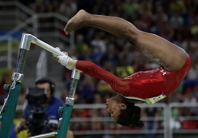 <p>United States' Gabrielle Douglas performs on the uneven bars during the artistic gymnastics women's apparatus final at the 2016 Summer Olympics in Rio de Janeiro, Brazil, Sunday, Aug. 14, 2016. (AP Photo/Rebecca Blackwell) </p>