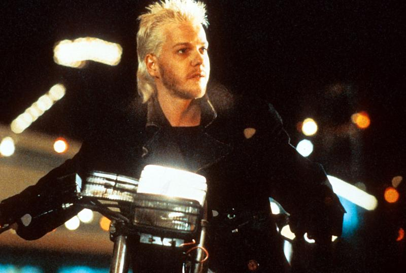 Kiefer Sutherland riding a motorcycle in a scene from the film 'The Lost Boys', 1987. (Photo by Warner Brothers/Getty Images)