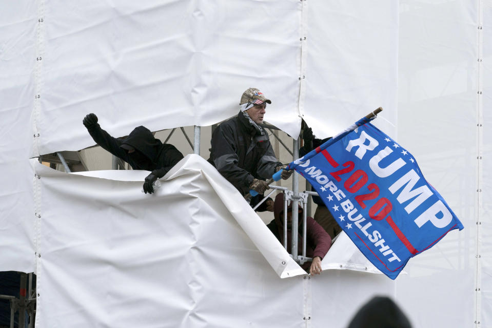 FILE - In this Jan. 6, 2021, file photo, supporters of then-President Donald Trump are seen outside the Capitol in Washington. (AP Photo/Jose Luis Magana, File)