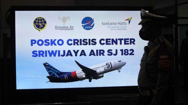 PHOTO: A security personnel stands in front of a sign for a crisis centre for Sriwijaya Air flight SJY182 at the Soekarno-Hatta international airport in Tangerang near Jakarta , Jan. 9, 2021. (Fajrin Raharjo/AFP via Getty Images)