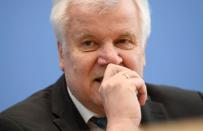 German Interior Minister Horst Seehofer attends a news conference, in Berlin