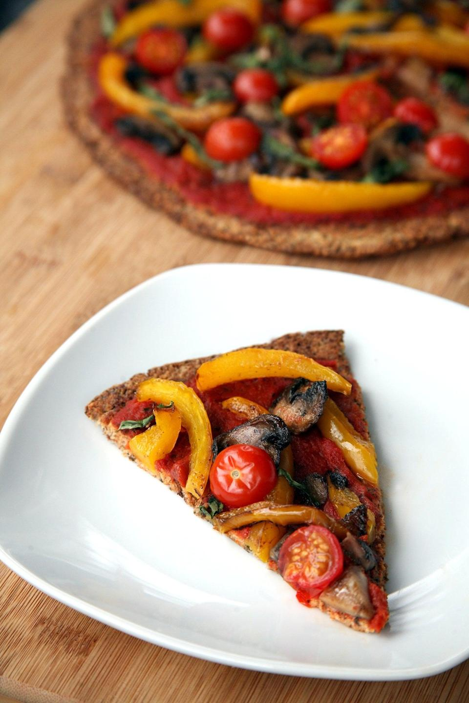 """<p>Now you can have cauliflower crust made without mozzarella or eggs, and this one is just as easy to make.</p> <p><strong>Get the recipe:</strong> <a href=""""https://www.popsugar.com/fitness/Vegan-Cauliflower-Pizza-Crust-41168545"""" class=""""link rapid-noclick-resp"""" rel=""""nofollow noopener"""" target=""""_blank"""" data-ylk=""""slk:vegan cauliflower pizza crust"""">vegan cauliflower pizza crust</a></p>"""