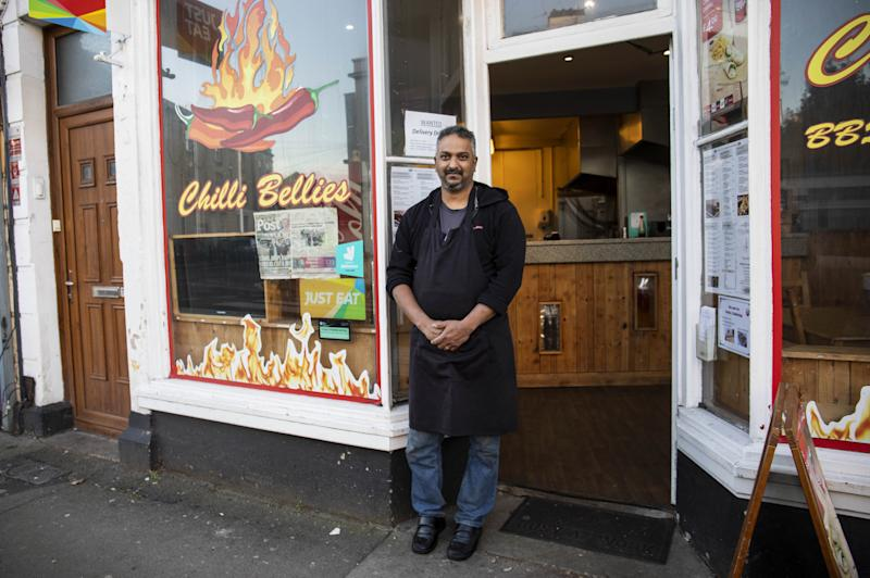 Neil D'Souza, owner of Chilli Bellies, says he is losing hundreds of pounds because of the policy. (SWNS)