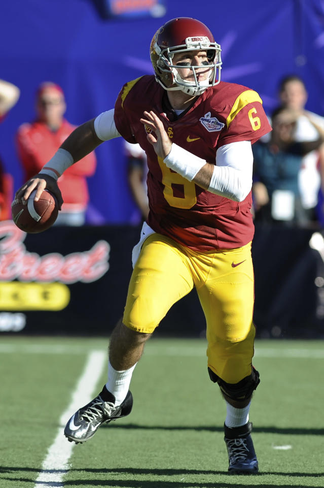 Southern California quarterback Cody Kessler looks for a receiver against Fresno State in the first quarter of the Royal Purple Bowl NCAA college football game, Saturday, Dec. 21, 2013, in Las Vegas. (AP Photo/David Cleveland)