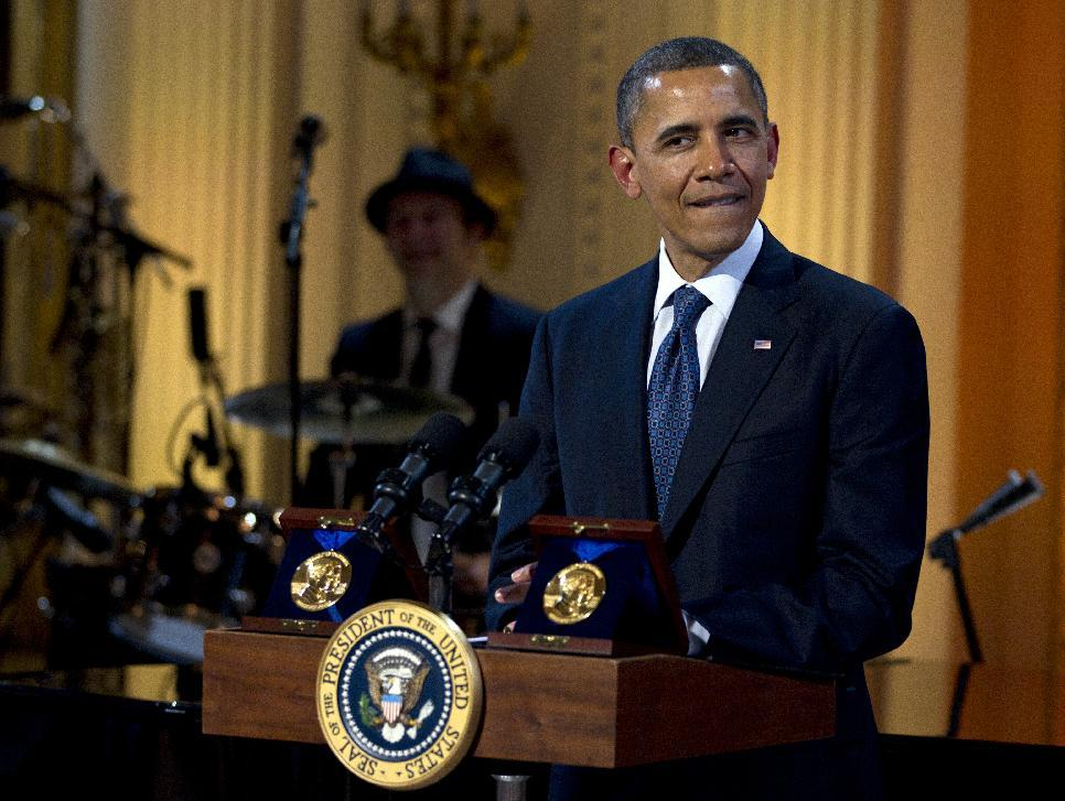 """President Barack Obama pauses as he speaks during the """"In Performance at the White House"""" in the East Room of the White House, Wednesday, May 9, 2012, in Washington, honoring songwriters Burt Bacharach and Hal David, recipients of the 2012 Library of Congress Gershwin Prize for Popular Song. (AP Photo/Carolyn Kaster)"""