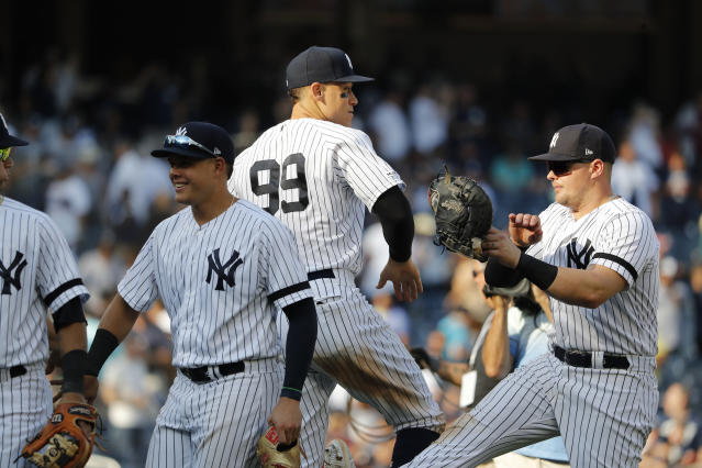 New York Yankees' Aaron Judge (99) celebrates with' Luke Voit after defeating the Toronto Blue Jays 8-3 in a baseball game, Sunday, Sept. 22, 2019, in New York. (AP Photo/Michael Owens)