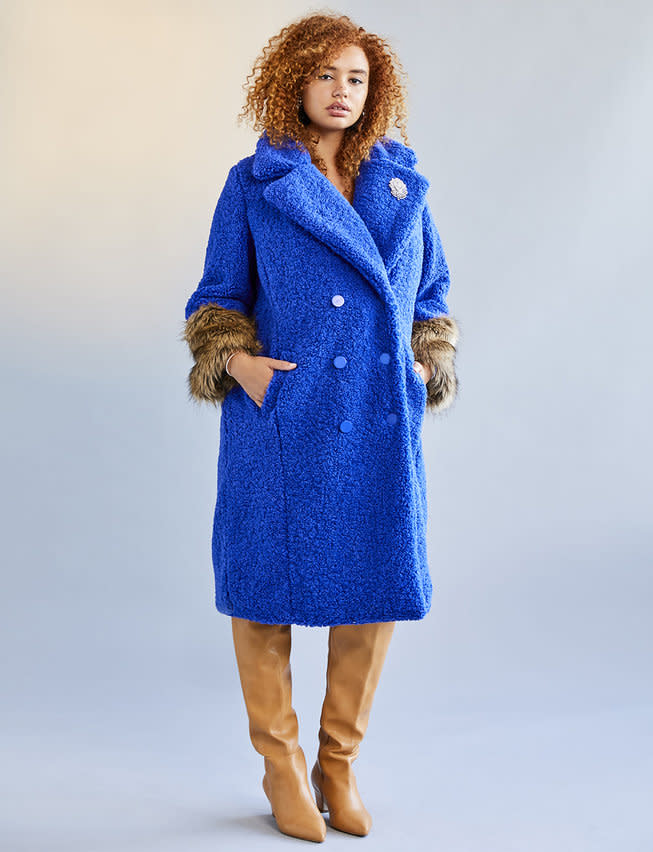 """<p>This super warm and chic cobalt boucle jacket is the perfect addition to any little black dress!<br /><a rel=""""nofollow"""" href=""""https://go.skimresources.com?id=125078X1586062&xs=1&url=https%3A%2F%2Fwww.eloquii.com%2Fboucle-coat-with-fur-cuffs%2F1256950.html%3Fdwvar_1256950_colorCode%3D9%20""""><strong>Shop it:</strong></a> Boucle Coat With Fur Cuffs, $180, <a rel=""""nofollow"""" href=""""https://go.skimresources.com?id=125078X1586062&xs=1&url=https%3A%2F%2Fwww.eloquii.com%2Fboucle-coat-with-fur-cuffs%2F1256950.html%3Fdwvar_1256950_colorCode%3D9%20"""">eloquii.com</a> </p>"""