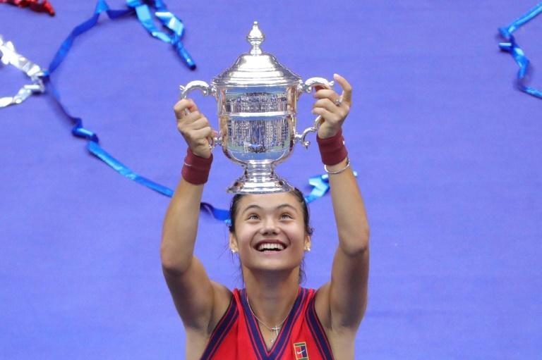 Britain's Emma Raducanu celebrates with the US Open championship trophy after beating Canada's Leylah Fernandez in Saturday's final (AFP/Kena Betancur)