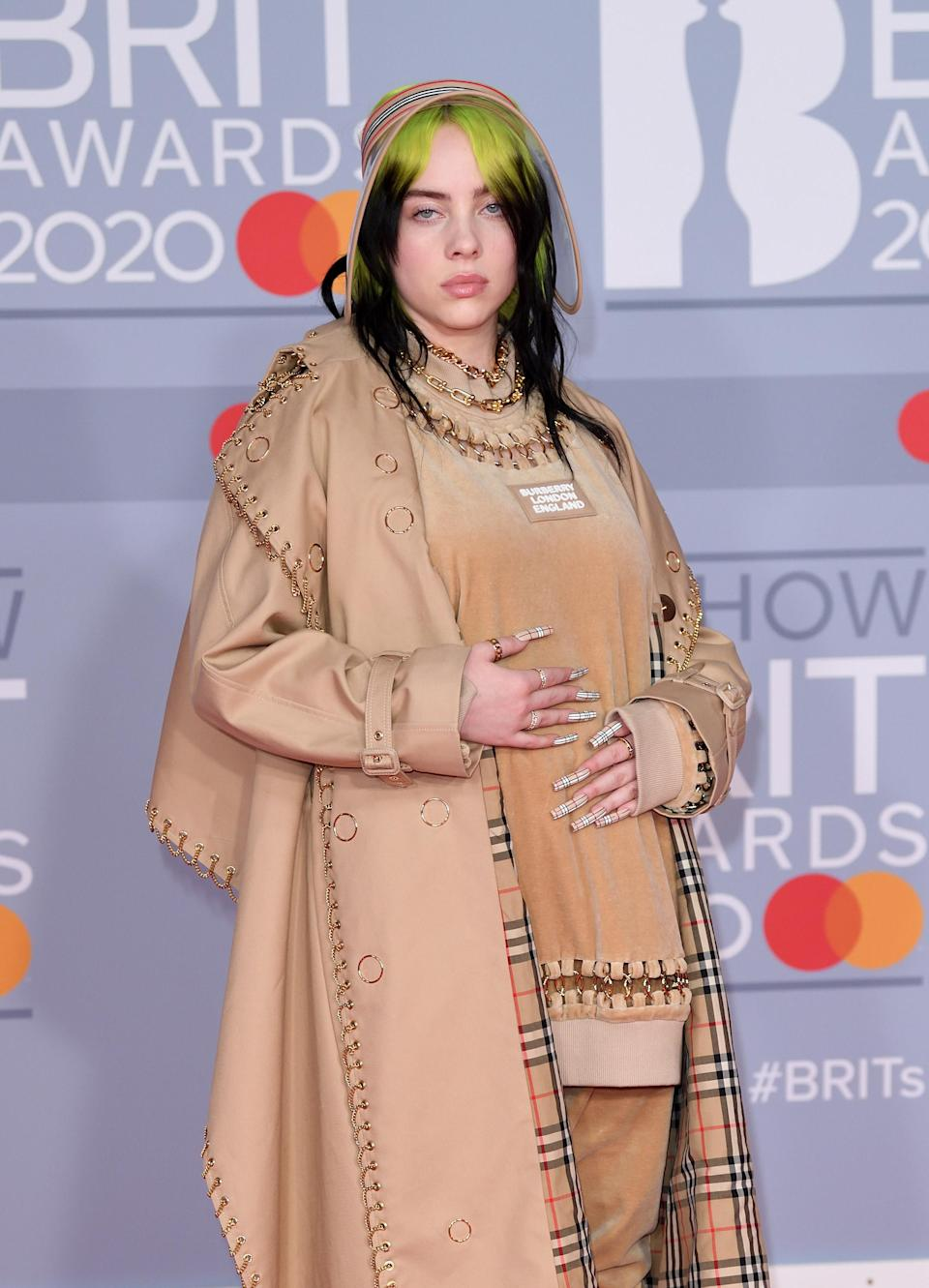 Billie on the red carpet in a loose trench coat