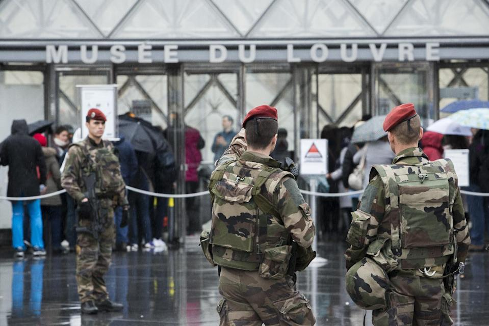 """French soldiers patrol in the courtyard of the Louvre museum with the visitor control in background in Paris, Saturday, Feb. 4, 2017. The Louvre in Paris reopened to the public Saturday morning, less than 24-hours after a machete-wielding assailant shouting """"Allahu Akbar!"""" was shot by soldiers, in what officials described as a suspected terror attack. (AP Photo/Kamil Zihnioglu)"""