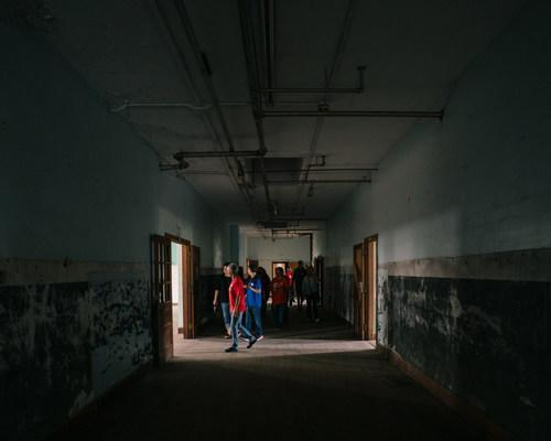 The 100-year-old abandoned school was open for tours at the ceremonial brick-breaking on October 9.