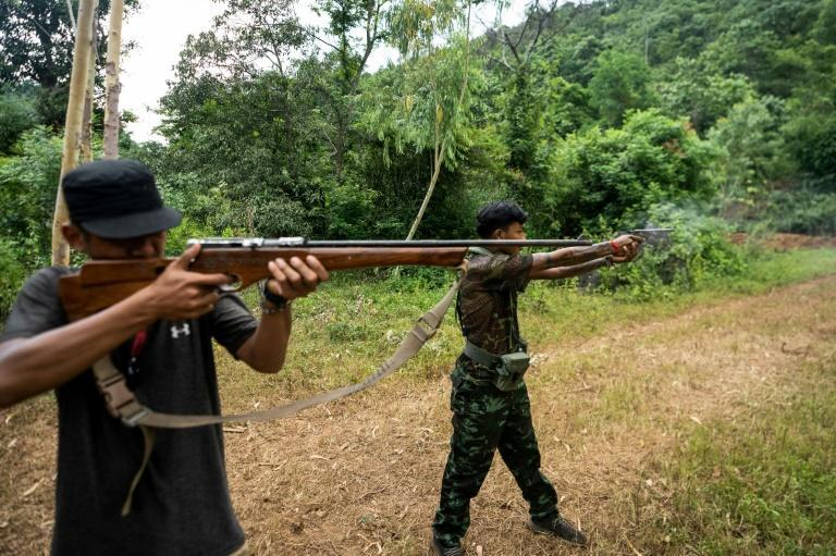 With their hunting rifles or weapons manufactured at makeshift factories, the volunteers are often outgunned against the Tatmadaw -- but are determined to fight on