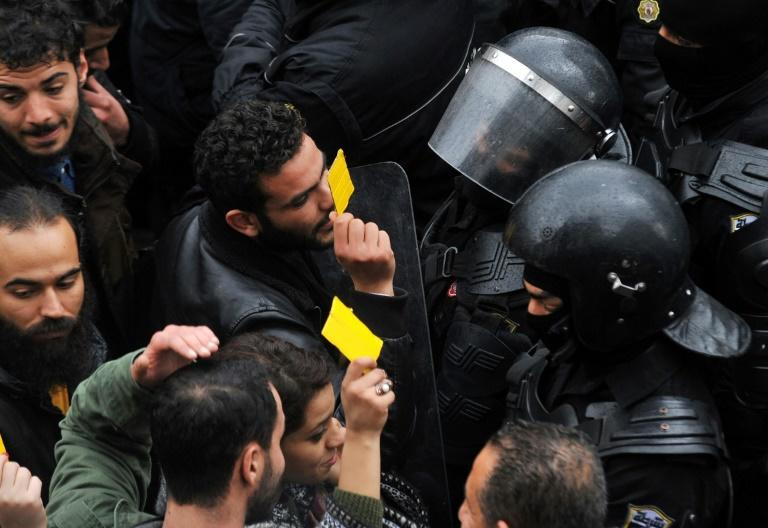 Tunisian protesters confront security forces blocking access to the governorate's offices in Tunis during a demonstration over price hikes and austerity measures on January 12, 2018