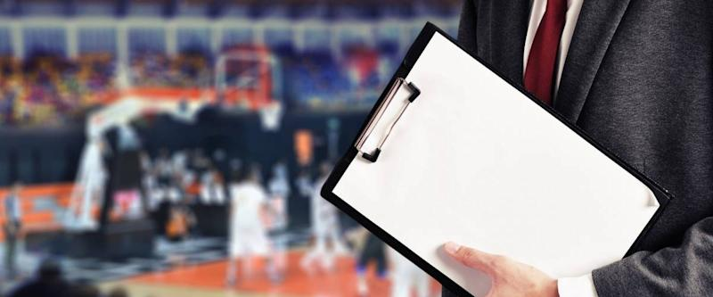 man hold report at basketball game