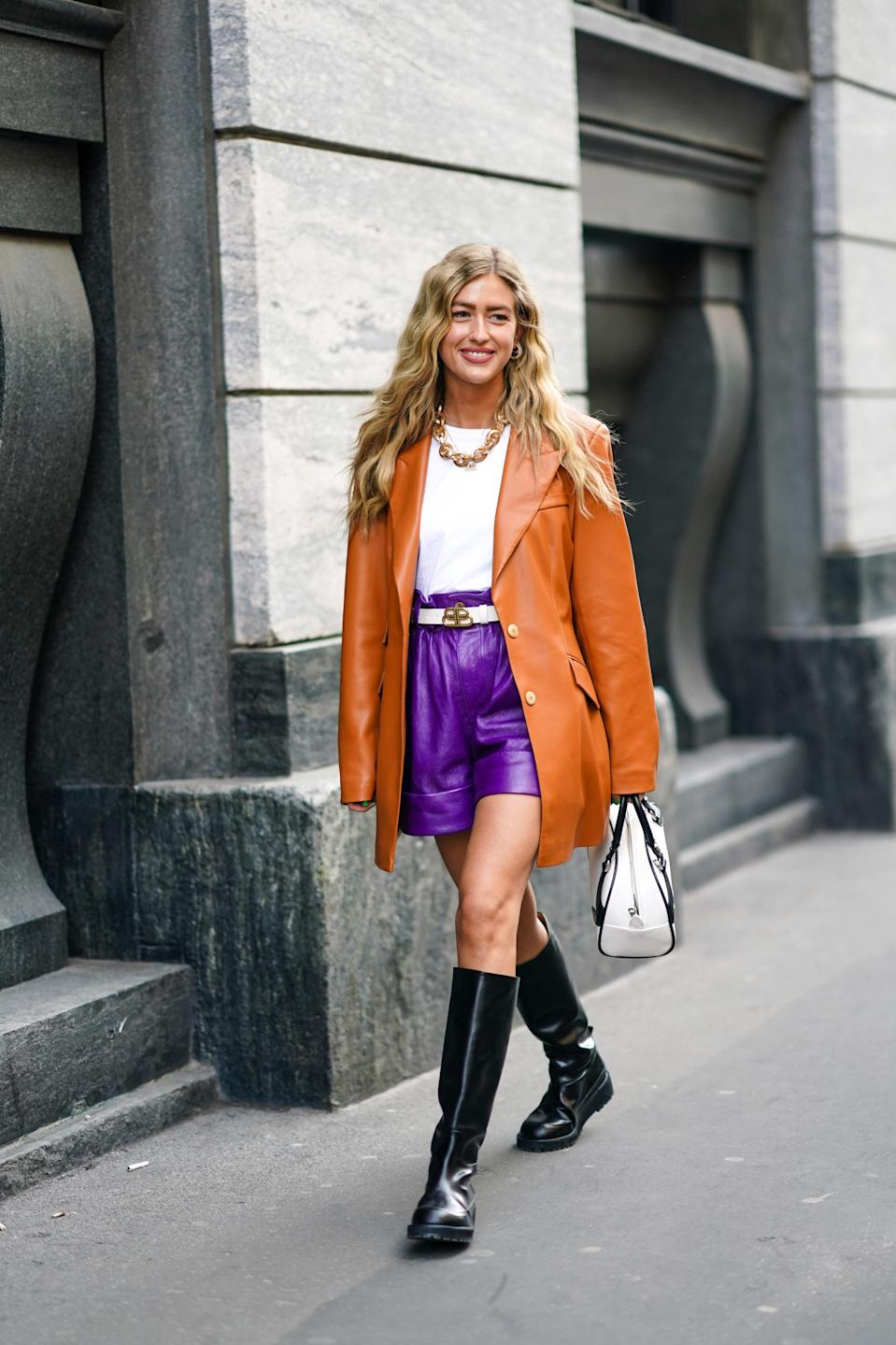 """Virtually everything in our closet has been given the leather update (from <a href=""""https://www.glamour.com/gallery/22-spring-suits-that-will-convince-you-to-swap-out-your-sundress?mbid=synd_yahoo_rss"""" rel=""""nofollow noopener"""" target=""""_blank"""" data-ylk=""""slk:suit separates"""" class=""""link rapid-noclick-resp"""">suit separates</a> to <a href=""""https://www.glamour.com/gallery/best-spring-dresses?mbid=synd_yahoo_rss"""" rel=""""nofollow noopener"""" target=""""_blank"""" data-ylk=""""slk:spring dresses"""" class=""""link rapid-noclick-resp"""">spring dresses</a>), but investing in a leather staple will go a long way in your wardrobe. Instead of opting for an accent piece like a <a href=""""https://www.glamour.com/story/best-headbands?mbid=synd_yahoo_rss"""" rel=""""nofollow noopener"""" target=""""_blank"""" data-ylk=""""slk:headband"""" class=""""link rapid-noclick-resp"""">headband</a> or removable collar, consider a blazer, trouser, or button-up. It'll be just as effortless to style as its non-leather counterpart, but the texture will instantly elevate your entire look."""