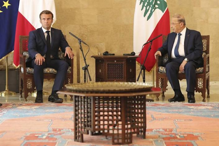 "French President Emmanuel Macron, left, and Lebanese President Michel Aoun meet Thursday. Macron visited Beirut to offer French support to Lebanon after the deadly port blast. <span class=""copyright"">(Thibault Camus / Pool report via Associated Press)</span>"